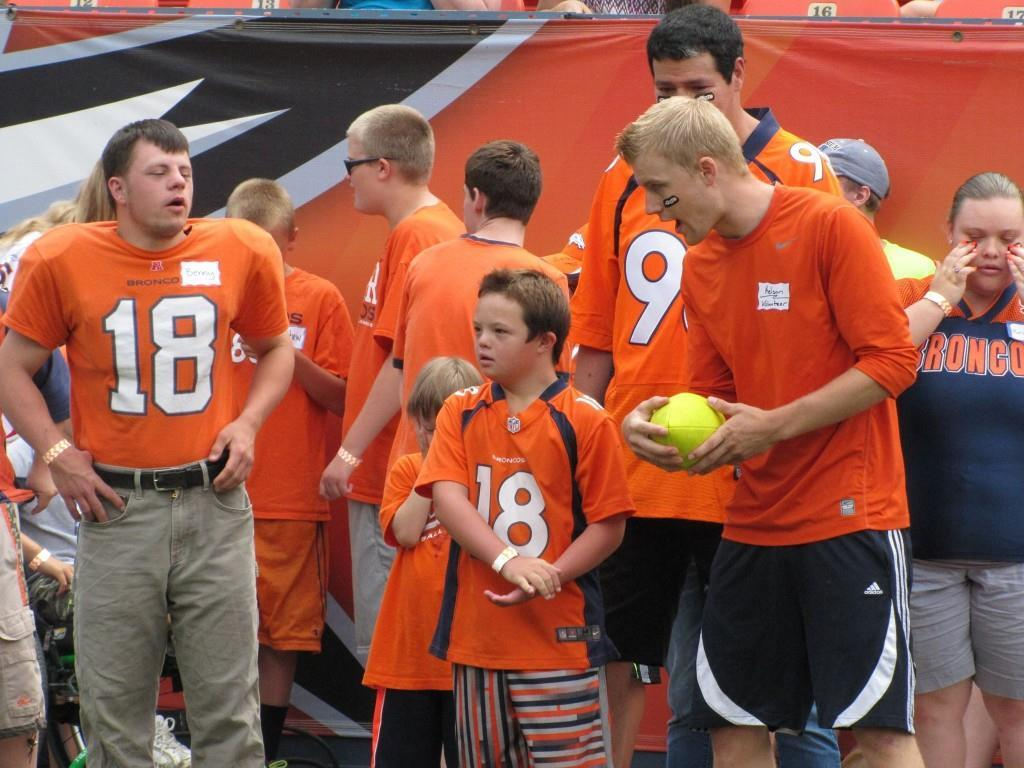 NSCD athletes receive some last-minute coaching before hitting the field at the Denver Broncos Football Ability Clinic. Credit.