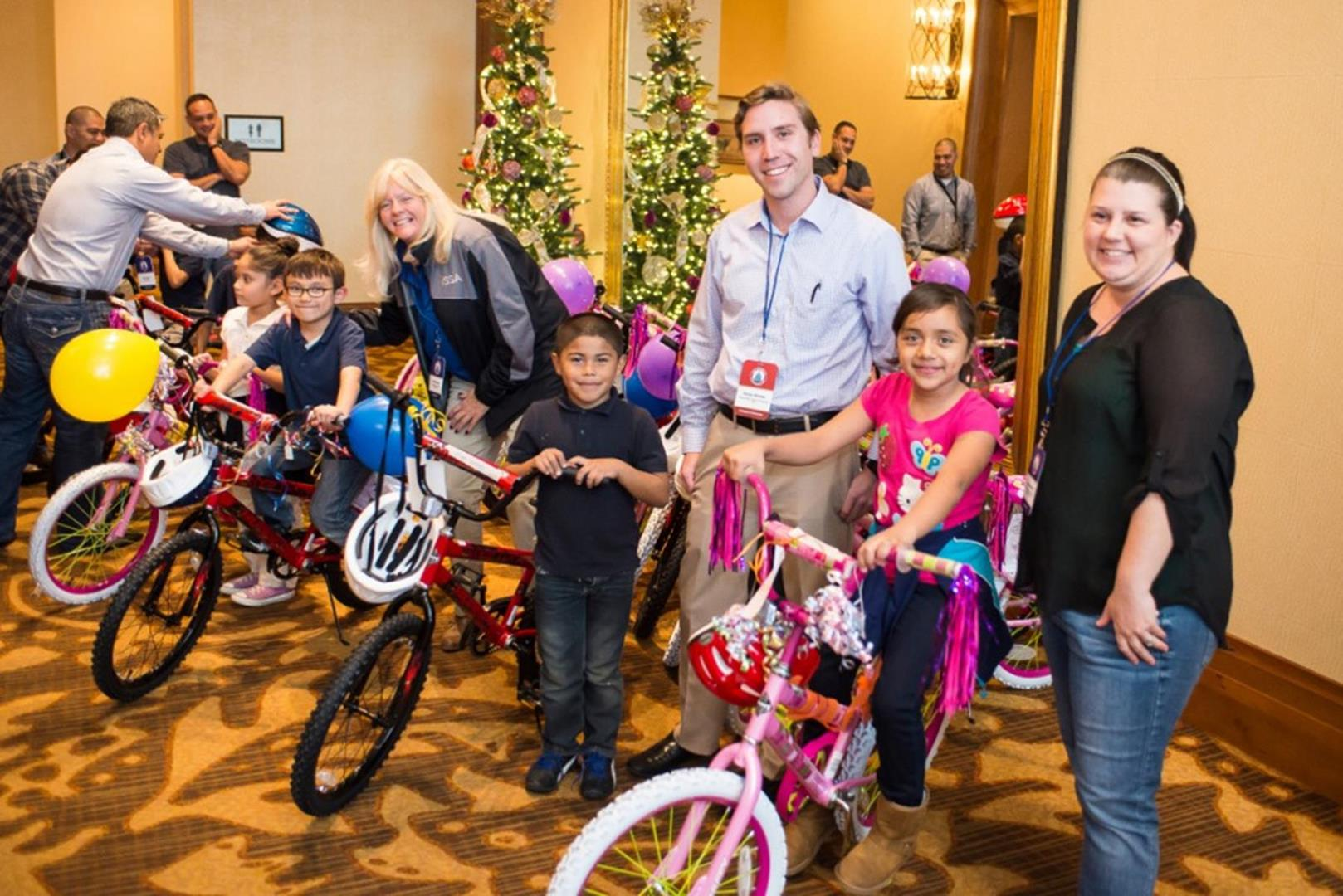 Parker Medley from Marco Island/Naples Sports helps kids choose a bike.