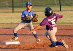 Evan Smart waits with the ball at second base to tag out base runner Max Kidwell. Photo by Jim Davis/Murfreesboro Parks & Rec.