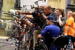 U.S. Special Operations Command Veteran Israel Del Toro, Jr., a Joliet, Ill., native, uses his teeth to draw the arrow on his compound bow at the 2016 DoD Warrior Games at the U.S. Military Academy at West Point, N.Y. The Warrior Games is a Paralympic-style adaptive sports competition for wounded, ill and injured Service members and veterans. (U.S. Army photo by Sgt. Joshua Brownlee/Released)