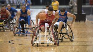 Marine Corps veteran Lance Corp. Matthew Grashen chases down a loose ball against Team Air Force in preliminary wheelchair basketball competition during the 2017 Department of Defense (DoD) Warrior Games in Chicago, Ill., June 30, 2017. The DoD Warrior Games are an annual event allowing wounded, ill and injured service members and veterans to compete in Paralympic-style sports including archery, cycling, field, shooting, sitting volleyball, swimming, track and wheelchair basketball.