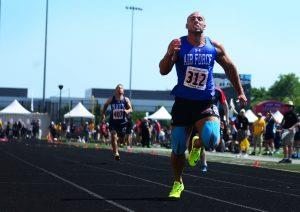 U.S. Air National Guard Staff Sgt. Matt Cable, a security forces troop from Great Falls, Mont., sprints toward the finish line of the 100 meter dash at the 2017 Warrior Games July 2, 2017 at Lane Technical College Preparatory High School, Chicago, Ill. Cable garnered first place overall for the event in his category.